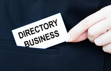A Businessman Put In His Pocket A Business Card With A DirectorY BUSINESS Tact.