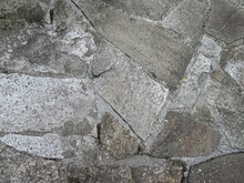 Stones Of Various Shapes In Concrete.