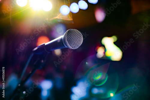 Fotografija Microphone on stage against a background of auditorium.