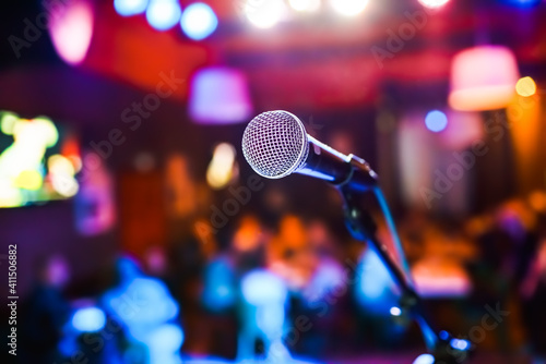 Microphone on stage against a background of auditorium. Fototapeta
