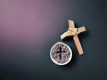 Lent Season,Holy Week And Good Friday Concepts - Image Of Bowl Of Ash With Cross Made Of Palm Leave Background. Stock Photo.