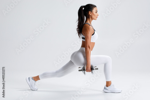Fitness woman doing lunges exercises for leg muscle training Wallpaper Mural