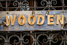 Closeup Of A Wooden Store Sign With Capital Letters, Photography, Full Frame.