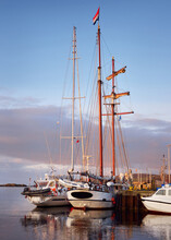 Sailboats Moored To A Pier In A Yacht Marina, Close-up. A View Of The Shore Of A Small Town Port Ellen At Sunrise. Isle Of Islay, Inner Hebrides, Scotland, UK. Sailing, Cruise, Recreation, Tourism
