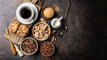 Cup Of Coffee With Chocolate Drop Cookies, Bowls Of Brown Cane Lump And Granulated Sugar, Crystal Sugar Sticks, Milk And Coffee Beans
