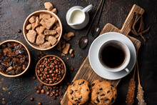 Cup Of Coffee With Chocolate Drop Cookies, Bowls Of Brown Cane Lump Sugar, Crystal Sugar Sticks, Milk And Coffee Beans