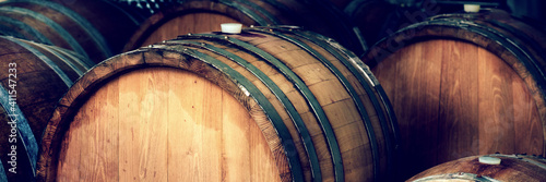 Fotografia wine barrels in a cellar, detail of the bung