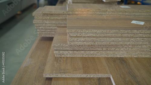 Fototapeta Fiberboard at a furniture factory. Boards at the factory close-up. Fragment of a wooden panel made of fiberboard in workshop. Medium Density Fiberboard MDF . obraz na płótnie