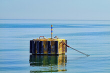 Calm Baltic Sea And A Buoy On Which A Seagull Sat.