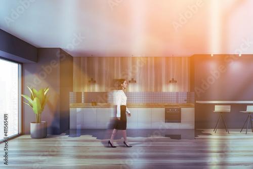 Carta da parati Attractive business woman walking around corporate kitchen in skyscraper office