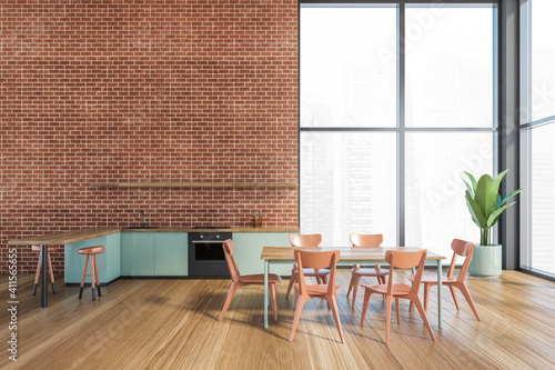 Cuadros en Lienzo Modern kitchen interior with copy space on red brick wall, wooden countertops with a built in sink and a cooker