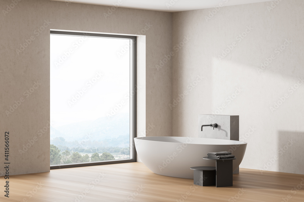 Fototapeta Wooden bathroom interior with a white bathtub, big panoramic window.