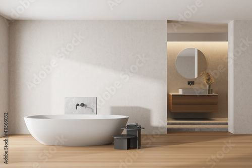 Fototapeta White bathroom interior with a white tub, sinks and round mirrors. mock up obraz