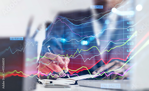 Fotomural A financial analyst is making notes and trying to settle a new approach to deal with clients needs to boost the business and achieve exceptional financial results