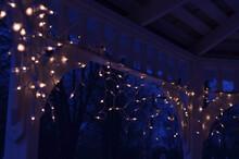 Abstract Background Deep Blue Sharp Focus And Bokeh Defocused Mini Light Patterns Inside Gazebo