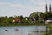 People In Lake Against Sky