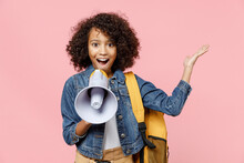 Surprised Leader Little African American Kid School Girl 12-13 Years Old In Casual Clothes With Backpack Scream In Megaphone Spread Hand Isolated On Pastel Pink Background Childhood Education Concept.