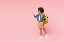 Full Length Happy Little African American Kid School Girl 12-13 Year Old In Casual Clothes, Backpack Do Winner Gesture Clench Fist Look Aside Isolated On Pink Background. Childhood Education Concept