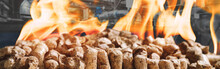 Wood Pellets For Heating Industrial Boilers With Bio Fuel In Fire Against Boilers Background. Composite Mixed Media Banner Image . Modern Low Cost Energy Concept