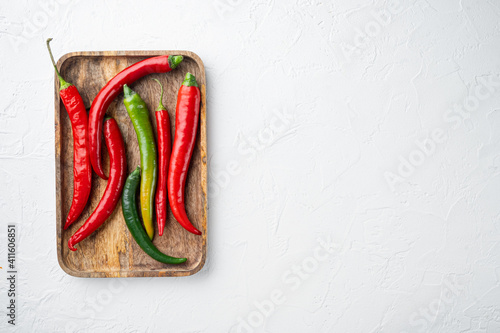 Ripe Red and green chili pepper, on wooden tray, on white background, top view f фототапет