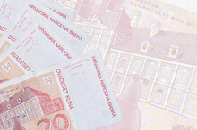 20 Croatian Kuna Bills Lies In Stack On Background Of Big Semi-transparent Banknote. Abstract Business Background