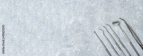Fotografija Dentist tools and mask on grey background