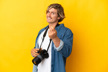 Young Photographer Man Isolated On Yellow Background Making Money Gesture