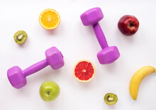 Flat Lay With Pink Kettlebells And Fresh Fruits For A Healthy Lifestyle