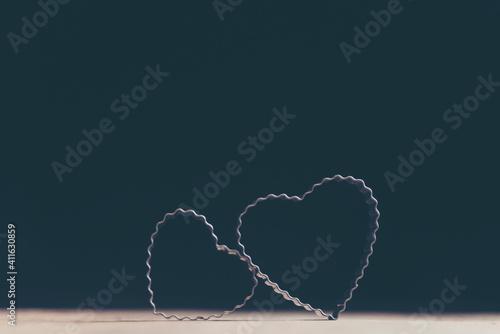 Fototapeta Close-up Of Heart Shape Pastry Cutter On Table Against Black Background obraz
