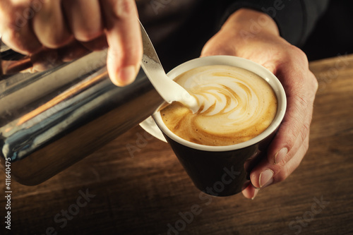 Obraz Milk foam poured into a  cup to form a perfect cappuccino - fototapety do salonu