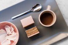 Pink Cake, Coffee And Petals On Grey Background