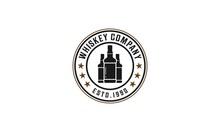 Whiskey Logo With Three Whiskey Bottles On White Background