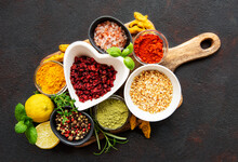 Dry Seasonings And Spices Against A Dark Background View From The Top.