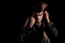 Portrait Of Man Wearing Mask Against Black Background