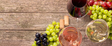 Variety Of Wine And Snack Set. Different Types Of Grapes. Fresh Ingredients On Wooden Background.