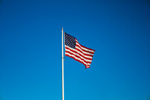 American Flag On Sky Waving In The Wind