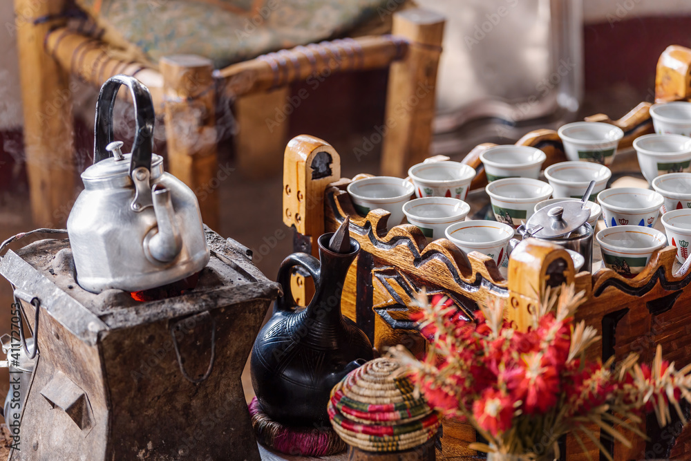 Fototapeta place with cups of Ethiopian coffee served with aromatic essence called buna. Frankincense and myrrh ignited by a hot coal to produce smoke that carries away any bad spirits. Ethiopia, Africa