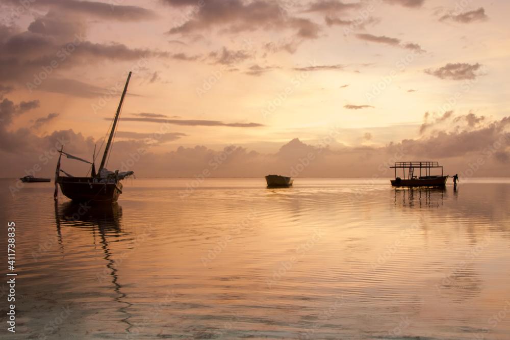 Fototapeta Boat In Sea Against Sky During Sunset