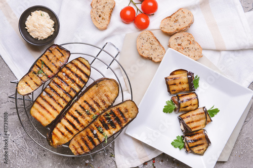 Fototapeta Tasty grilled eggplant on grunge background obraz
