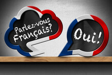 3D Illustration Of Two Speech Bubbles With French Flag And Question Parlez-vous Francais? And Oui! (Do You Speak French? And Yes!). On A Wooden Shelf With A Wall On Background.