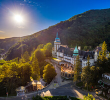 Lillafured, Hungary - Aerial View Of The Famous Lillafured Castle In The Mountains Of Bukk Near Miskolc On A Sunny Summer Morning. Rising Sun With Sunrays And Clear Blue Sky