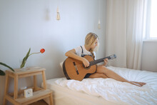 Gir Learning To Play Guitar At Home