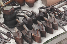 Old Rusty Original Houseware. Outdated Charcoal Irons, Pots And Various Retro Items On Sale. Toned