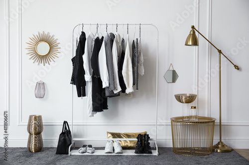Obraz Rack with stylish clothes near white wall in dressing room - fototapety do salonu