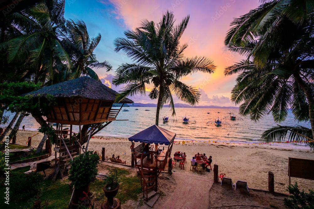 Fototapeta Port Barton Beach at sunset on paradise island, tropical travel destination - Port Barton, San Vicente, Palawan, Philippines.