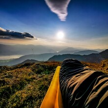 Panoramic View Of Landscape Against Sky During Sunrise From Sleeping Bag