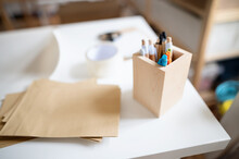 Wooden Box Container Holder With Pens On Desk, Natural Decor Concept.