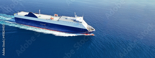 Obraz na plátně Aerial drone ultra wide photo of large RoRo (Roll on-off) vessel cruising the At