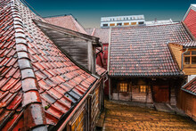 Wet Roofs Of Old Wooden Buildings  In Bryggen District, Bergen, Norway.
