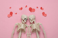 Two Skeletons And Red Hearts On A Blue Background. Valentine's Day, Halloween Concept